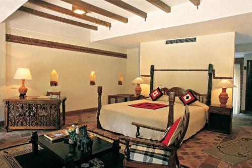 A bed or beds in a room at The Dwarika's Hotel