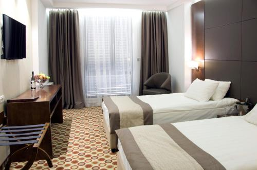 A bed or beds in a room at Central Hotel Sofia