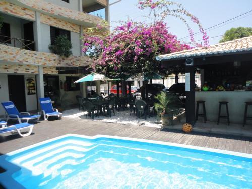 The swimming pool at or near Pousada Beija Flor