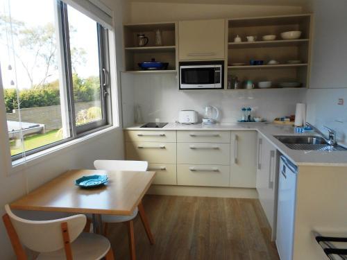A kitchen or kitchenette at Oneroa Secret Garden Apartments