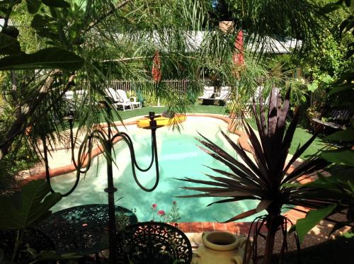 A view of the pool at Coach House Inn or nearby
