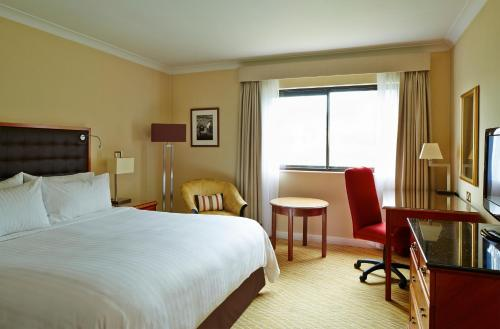 A bed or beds in a room at Swansea Marriott Hotel