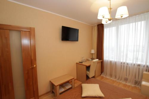 A television and/or entertainment center at Intourist Hotel