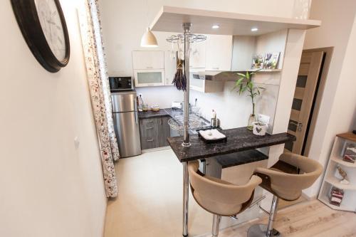 Kuchyňa alebo kuchynka v ubytovaní Apartment Diana