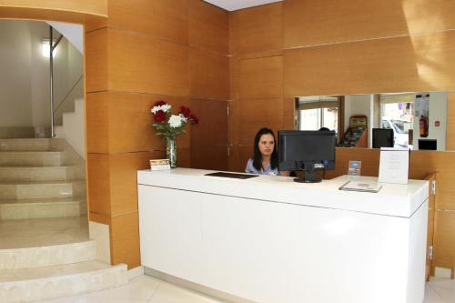 The lobby or reception area at Hotel Colon