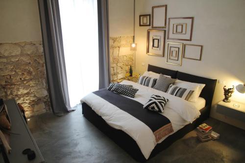 Letto o letti in una camera di Shurhuq Ospitalità Siciliana