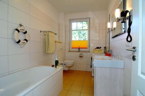 Ein Badezimmer in der Unterkunft Appartementhaus Ostseeresidenz