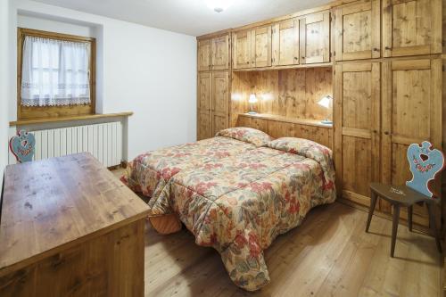 Cama o camas de una habitación en Villa Lacedel - Stayincortina