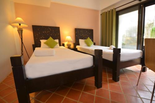 A bed or beds in a room at PapaCrab Boutique Guesthouse