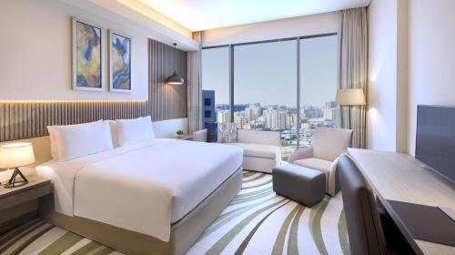 A bed or beds in a room at DoubleTree by Hilton Doha Old Town