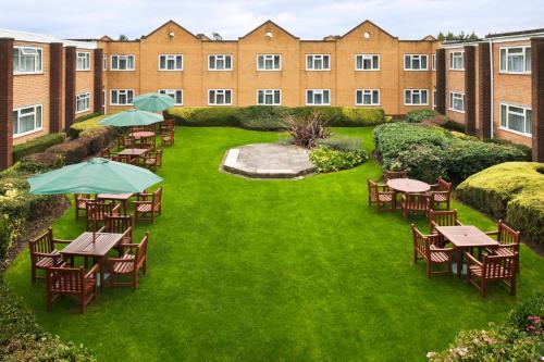 A garden outside Holiday Inn Chester South, an IHG Hotel