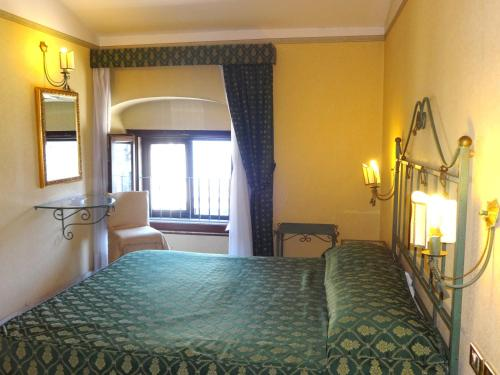 A bed or beds in a room at Hotel Centrale Europa