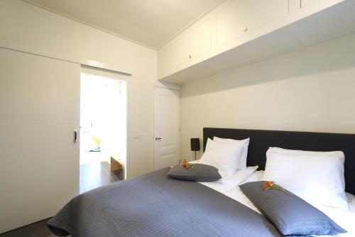 Een bed of bedden in een kamer bij Suite aan de A