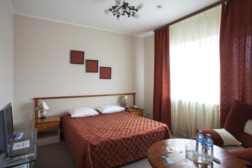 Кровать или кровати в номере Гостиница-отель Inshinka-SPA