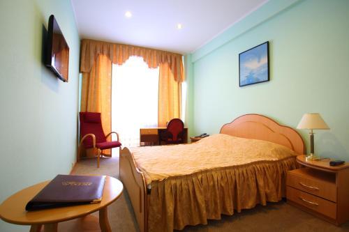 Кровать или кровати в номере Гостиница Россия