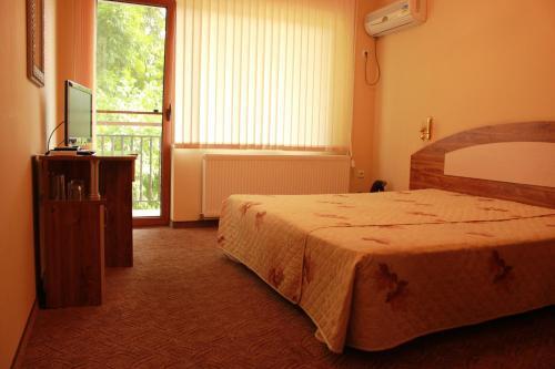 Кровать или кровати в номере Hotel Sredna Gora