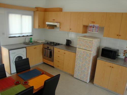 Кухня или мини-кухня в Miris Mediterraneo Apartments
