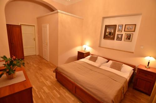 A bed or beds in a room at Pension Karlova
