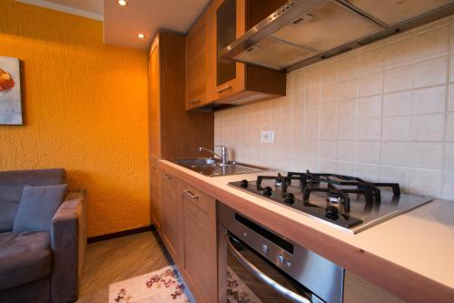 Kuchyň nebo kuchyňský kout v ubytování Ariete Apartments