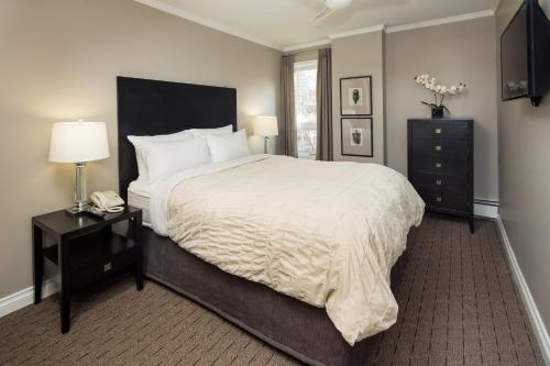A bed or beds in a room at ExecSuite Inc.