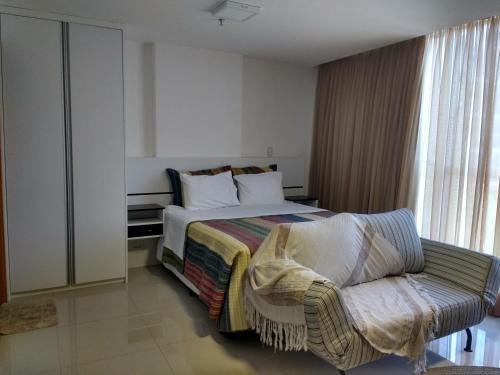 A bed or beds in a room at Flat em Brasília