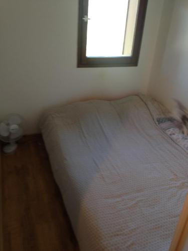 A bed or beds in a room at Appartement Tout Confort