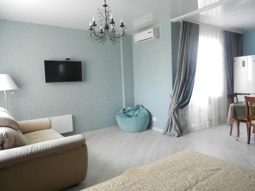 Кровать или кровати в номере Apartment na Revolutsii