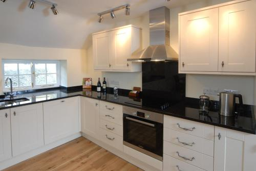 A kitchen or kitchenette at Unicorn Aparthotel Suites