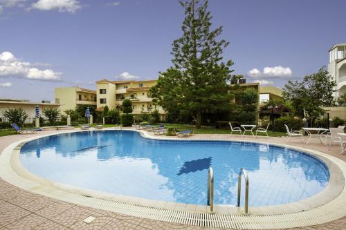 The swimming pool at or near Lyristis Studios & Apartments