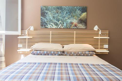 Letto o letti in una camera di Mondello Suites Feels Like Home