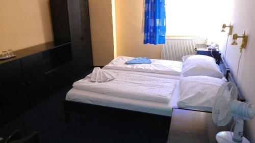 Postel nebo postele na pokoji v ubytování Hotel CB Royal
