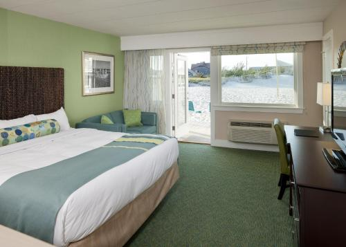 A bed or beds in a room at Sea Crest Beach Hotel