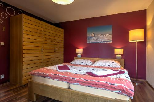 A bed or beds in a room at Apartmány Barto21