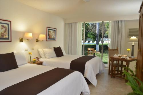 A bed or beds in a room at Mision Ciudad Valles
