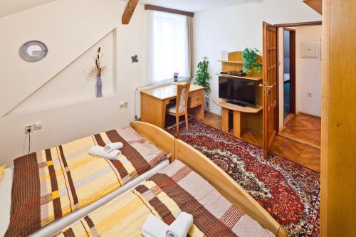 Кровать или кровати в номере Pension Fontána Svitavy