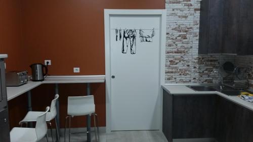 A kitchen or kitchenette at Albergue Bide-Ona