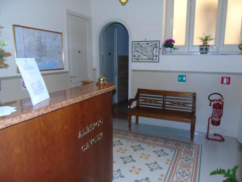 The lobby or reception area at Albergo Cavour