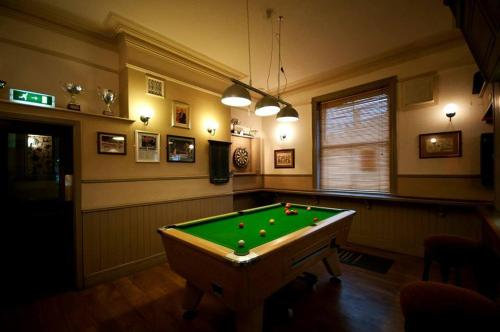 A pool table at Locomotion Hotel