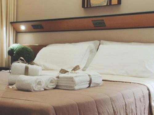 Letto o letti in una camera di Cristal Palace Hotel