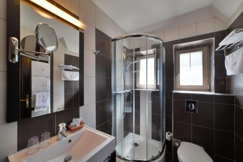 Koupelna v ubytování Hotel Berg