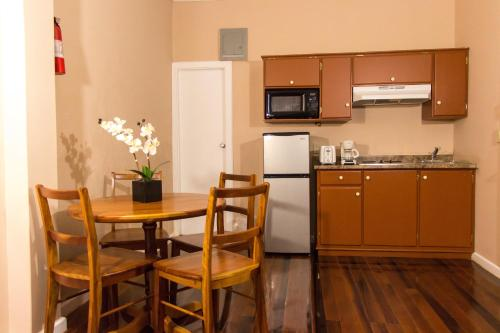A kitchen or kitchenette at The Durban Hotel Guyana INC.