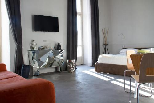 A television and/or entertainment center at Piazza Castello Suite