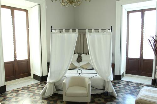 A bed or beds in a room at B&B Suite Cutelli