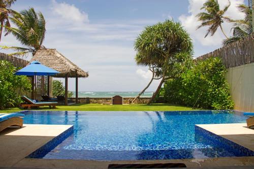 The swimming pool at or close to Villa Nilaya