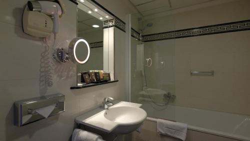 A bathroom at Apollofirst Boutique Hotel