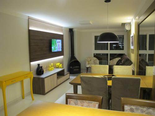 O lounge ou bar de Apartamento Centro Catedral