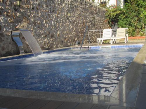 The swimming pool at or near Sabah Pension