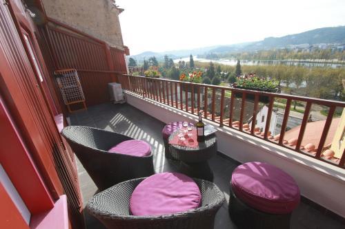 A balcony or terrace at Casas da Alegria