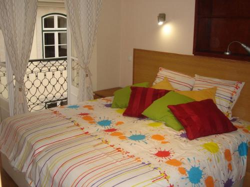 A bed or beds in a room at DownTown Guest House