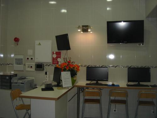 A television and/or entertainment center at DownTown Guest House